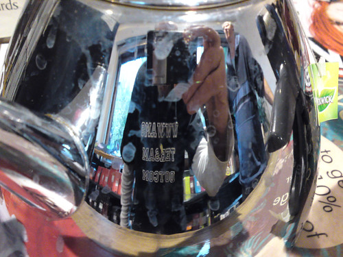 Unedited mobile phone cam shot of myself reflected on a tea-pot inside the ...
