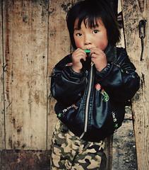 Whistling (ckyen.rm) Tags: china wood boy portrait cute kid nikon day adorable gansu whistling runningnose traveldestinations d80 1424mm taktsanglhamo