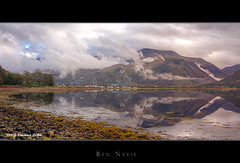 Ben Nevis (Kit Downey) Tags: mountain holiday seaweed west reflection water clouds canon landscape eos rebel scotland highlands still october rocks ben fort hill scottish peak overcast william tourist tokina explore kit loch iconic hdr nevis 550 downey explored t2i 1116mm