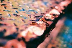Rusty Tread... (Trapac) Tags: pink blue summer england orange film xpro crossprocessed rust iron fuji slidefilm step fireescape nikkor50mmf18 ra sensia clevedon northsomerset nikonf80 100iso catacorner fujisensia wmh fujira