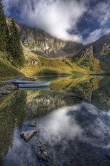 Lac Lioson (Philippe Saire || Photography) Tags: mountain lake alps reflection nature water montagne alpes canon landscape eos switzerland eau suisse lac sigma wideangle 1020mm paysage reflets hdr gettyimages barque photomatix 450d lioson philippesaire