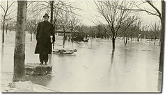 A flooded park in Logansport, Indiana (Hoosier Recollections) Tags: people usa man men history buildings clothing parks indiana rivers pedestrians streams logansport casscounty hoosierrecollections