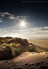 Lone Walker - Formby Point [Explored #234] (Lee Carus) Tags: autumn sea people irish sun beach grass clouds liverpool point sand god explore walker flare lone rays slt merseyside formby a55 explored