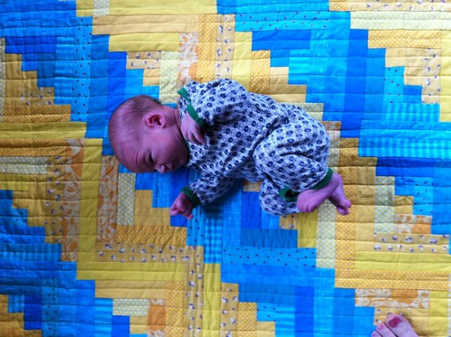 Baby Everett on his Bright Furrows quilt