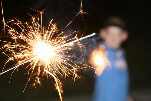Dueling sparklers by The Bacher Family