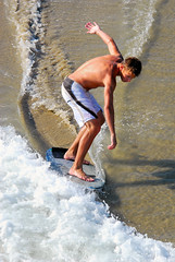Skimboarders (ScottS101) Tags: california boy summer male beach wet water muscles youth surf huntington tan teen foam boardshorts athlete huntingtonbeach hb allrightsreserved skim skimboard skimboarder boardsports sandsun copyrightscottsansenbach2008