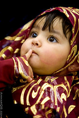Hushhhhh ! (Ammar Alothman) Tags: life portrait people baby cute eye girl beautiful face look canon kid eyes pretty child gulf sweet gorgeous adorable innocence kuwait ramadan ammar kuwaitcity kw 2007 q8 30d canon70200  canon30d   vwc chlidhood ammaralothman   3amar kuwaitiphotographer kuwaitphoto kuwaitphotos ammarq8 kvwc bachspicsgallery kuwaitvoluntaryworkcenter  kuwaitvwc q8photos ammarq8com  ramadanvwc07