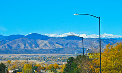 View of Snow Capped Rocky Mountains - Centenni...