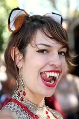 Vampire Beast (wyojones) Tags: texas texasrenaissancefestival toddmission pirate beauty woman girl wench dancer bellydancer vampireharemgirl brunette ears hair browneyes lips nose hairup festival fest renaissance renfest pretty lovely sword necklace allhallowseve halloween expression serious eyebrows cute earings animal beast beautiful smile tongue vampire fangs vampiress teeth freckles wyojones faire renaissancefestival renaissancefaire trf chainmail renfaire rennie