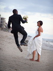 Wedding Day Leap (Noel Bass) Tags: wedding friends portrait white flower love beach happy groom bride jump couple day married dress walk african ceremony marriage happiness best lovers aisle tuxedo american fate destiny pedals bouquet hop engaged leap