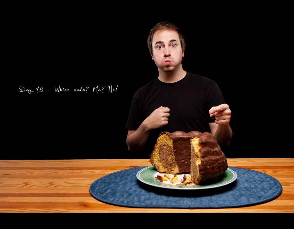 Day 98, 098/365, Project 365, Self Portrait, Strobist, cake, the cake is a lie, eat, full mouth, on black, black background, ourdailychallenge, rimllight, caught, catch, caught eating,