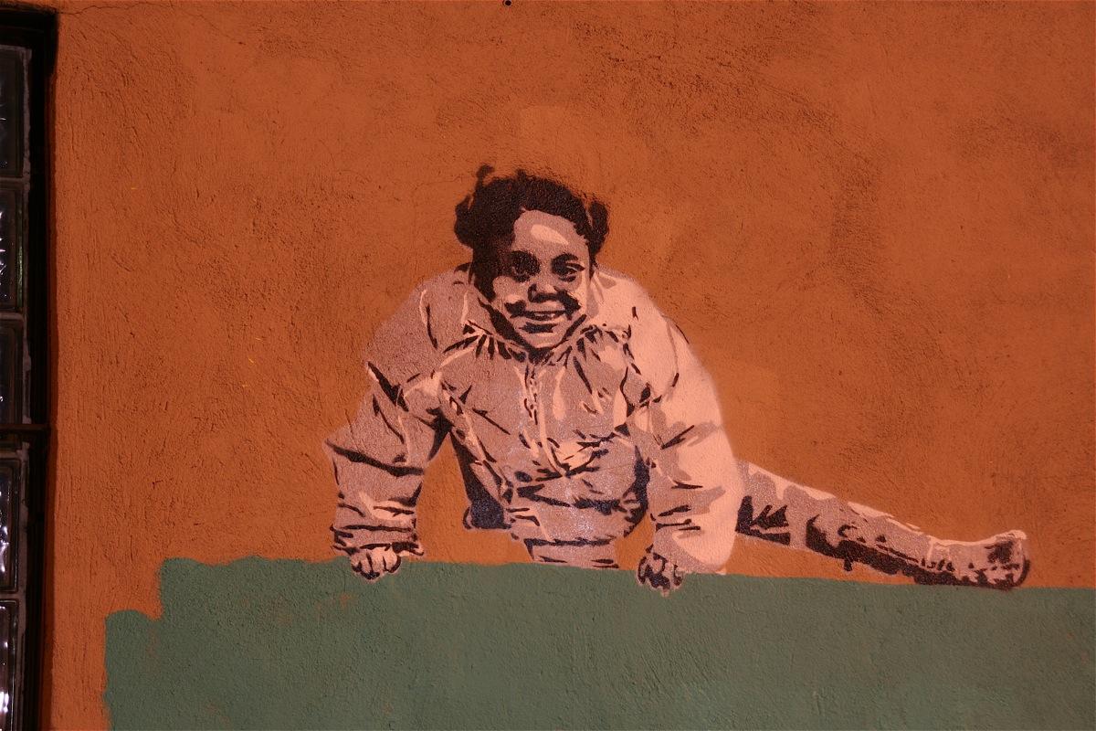 banksy climbover girl 1