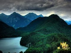 Darkness invades the kingdom (joiseyshowaa) Tags: travel vacation mountain lake holiday alps green castle yellow clouds forest germany landscape bayern deutschland bavaria swan bravo europe king tour mother royal kingdom tourist richard swanlake middle neuschwanstein ludwig wagner ages weeklysurvivor challenge royalty hdr touring breathtaking realm leopold feudal peopleschoice bigmomma mywinners travelerphotos jalalspagesmasterpiecealbum honenschwangau thechallengefactory joiseyshowaa thepinnaclehof joiseyshowa tphofweek50