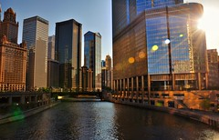 Sunset In The City (Seth Oliver Photographic Art) Tags: chicago illinois nikon midwest cityscapes sunsets trumptower chicagoriver hdr pinoy urbanscapes chicagoist lensflares travelphotography d90 sunflares skyscrapes chicagolandmarks thingstodoinchicago setholiver1 circularpolarizers