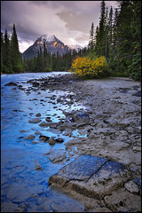 Gold-n-Blue Mountain Final (Mike Isaak) Tags: flowers blue light sunset lake canada mountains green nature water clouds landscape photography gold rocks jasper natural lakes rocky alberta banff filters polarizer waterscape d300s