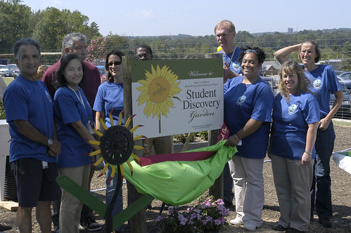 Beltsville Agricultural Research Center (BARC) employees at the unveiling of the sign for the BARC Student Discovery Garden.