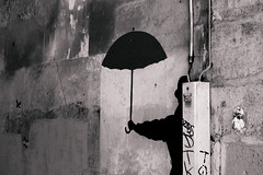 man with dark umbrella