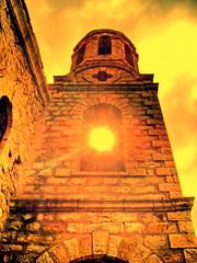 Light through the temple (Emilofero) Tags: sun tower church yellow stone clouds europe bell belltower bulgaria rodopi anawesomeshot diamondclassphotographer