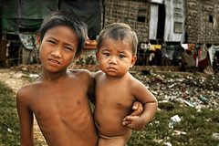 Andong Village, Cambodia - Letter to NGO (Mio Cade) Tags: boy baby kid singapore asia village child flood social help aid human rights disaster environment crisis phnom ngo penh drainage sewerage andong earthasia