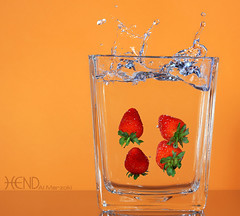 Strawberries (HeNd Almarzoki) Tags: macro canon photography eos strawberry strawberries sigma saudi f28 dg fresas 105mm fraises fragole  jordgubbar truskawki    ilek jiddah sigma105mmf28  hend jagode dgmacro       1000d canoneos1000d almarzoki