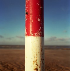 Pole. (DJ Bass) Tags: blue red white beach poles redwhiteandblue markers zone demarcation