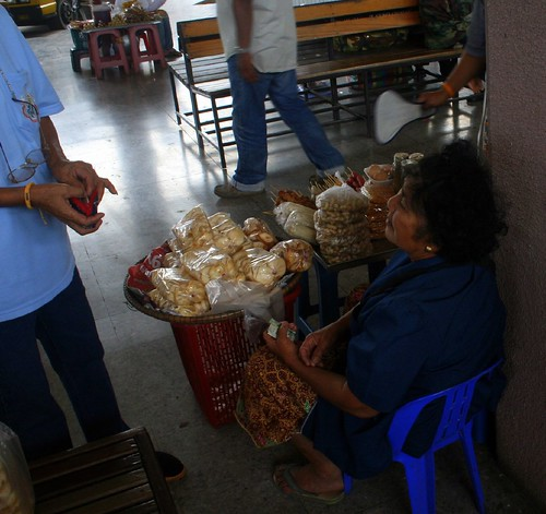 Woman selling snacks for the bus