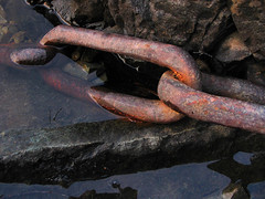 chained (axiepics) Tags: macro water chains rust rocks chain links theforgotten supershot copyrightalexskellyallrightsreserved
