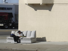 GUY ON ABANDONED COUCH