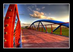 High Dynamic Bridge (Dimitri Depaepe) Tags: bridge blue sunset red sky colors clouds bravo raw pentax oostende hdr globalvillage photomatix magicdonkey flickrsbest artlibre globalcity invitedphotosonly gvadminshalloffame itsabeautifulgv