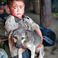 CHINA (BoazImages) Tags: life china boy dog pet cute asia culture forsakenpeople tribal dirty yunnan lolo yi indigenous documentry abigfave anawesomeshot superaplus aplusphoto goldenphotographer boazimages lpdirty