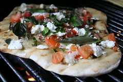 Grilled pizza with eggplant, tomatoes, goat cheese and basil
