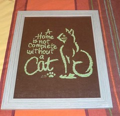 A home is not complete without a cat finally framed!