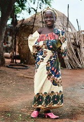 the pink shoes (janchan) Tags: africa pink portrait girl children shoes village retrato documentary nigeria ethnic ritratto kano reportage fulani hausa carrymehome whitetaraproductions
