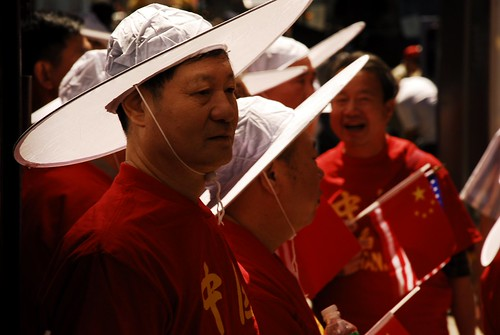 Chinese Men in the Sun Under White Hats Immigrants Parade 1
