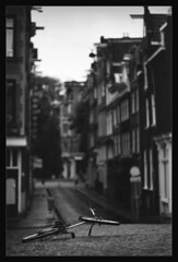 Lonely (Edd Noble) Tags: street bw amsterdam bike nikon f100 epson hp5 ilford 85mmf14d v700