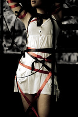 Tie Me Up, Tie Me Down ( w a a ) Tags: red black girl 50mm nikon ribbons d70s bondage tied anya