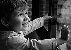 Sweet Portrait (Ganymede: Photography) Tags: portrait bw white black cute window monochrome smile blackwhite kid eyes nikon child bright sweet fine innocent gritty innocence enfant picnik d60 nikond60