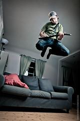 Guitar Hero 1 (Severin Sadjina) Tags: lighting light music playing man game home fun coach jump do guitar air livingroom sofa gaming videogame 24mm guitarhero octa elinchrom octabox rotalux deepocta elinchromquadra rotaluxocta elinchromrangerrxquadraas