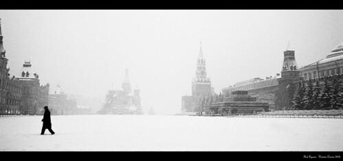 Red Square, Moscow Going through some old film from trips in Europe and came across this. A lone, mysterious man with red square to himself in the dead of a russian winter.   I like the romanticism of the pic. If you have a decent res, best seen large.  *Shot on Ilford XP2 Super* sometime in November, 2002.