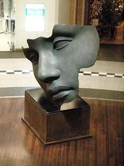 Mitoraj Bronze (WrldVoyagr) Tags: city sculpture art face bronze head poland polska shoppingcenter poznań mitoraj poznan igormitoraj wielkopolska starybrowar nv11