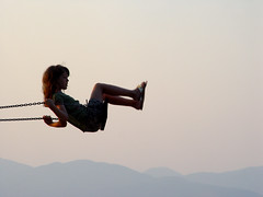 swing.me.2 (alefbetac) Tags: sunset mountains beach girl air swing greece peloponissos achaia