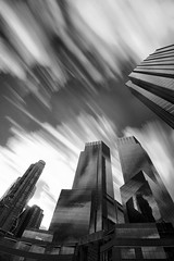 Time Slips By (Tourista de Mancunia) Tags: longexposure newyork clouds reflections manhattan canon20d midtown motionblur infrared daytime 1020mm columbuscircle 8thavenue glassblocks tallbuildings thebigapple r72 hearsttower trumphotel 15mins nearcentralpark timewarnershoppingcentre universalnewsandmagazinetower