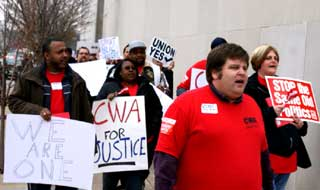 CWA Local 6355 President Bradley Harmon marches with members toward Missouri state capitol on Lobby Day.