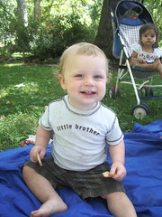 "Samuel at the park, saying ""cheeeese"" (Anabelle in back)"