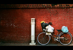 Bike with Bags (It's Stefan) Tags: poverty red urban brick muro rot texture bike bicycle wall composition rouge roc interestingness interesting rojo asia asien fuji ride pavement wand bricks rad  taiwan bicicleta social sidewalk plasticbag bici taipei asie bags minimalism formosa  mur footpath ilha  velo fahrrad plasticbags mauer plastiktte bicicletta backstein ilhaformosa confuciustemple  gehweg tte   armut  madeintaiwan ziegelstein canon1000f  republicofchinataiwan  biciclo  damenrad  datungdistrict nexttobaoantemple asien lpbicycles  stefanhoechst stefanhchst