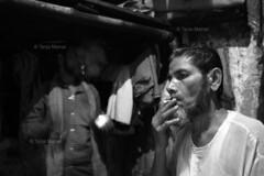 DSC_1128 (Tanja on flikr) Tags: 2005 bw india smoking rickshaw kolkata puller westbengal black38white