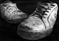 1000 miles (lowbattery) Tags: old blackandwhite bw shoes gritty dirty sneakers trainers explore miles decrepit lacoste laces wornout bwphotoaward aplusphoto