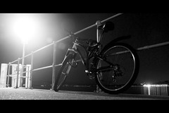 The forgotten bike (edouardv66) Tags: street blackandwhite bw bike night contrast switzerland blackwhite nikon suisse geneva mountainbike nb backlit d200 genve 18200 vr noirblanc