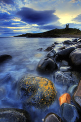 Dunstanburgh rocks (Corica) Tags: uk greatbritain england sky colour castle clouds photoshop landscape rocks northumberland hdr craster sigma1020mm dunstanburgh dunstanburghcastle northeastengland photomatix corica canon400d aplusphoto rumblechurn