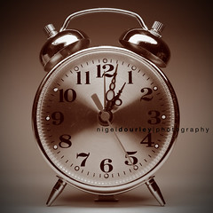 Vintage Alarm Clock (Nigel Dourley) Tags: light reflection alarm clock sepia canon vintage time retro explore duotone hours top20 coolest minutes seconds peopleschoice takeabow blueribbonwinner vignett 400d artlibre anawesomeshot aplusphoto diamondclassphotographer superhearts ysplix